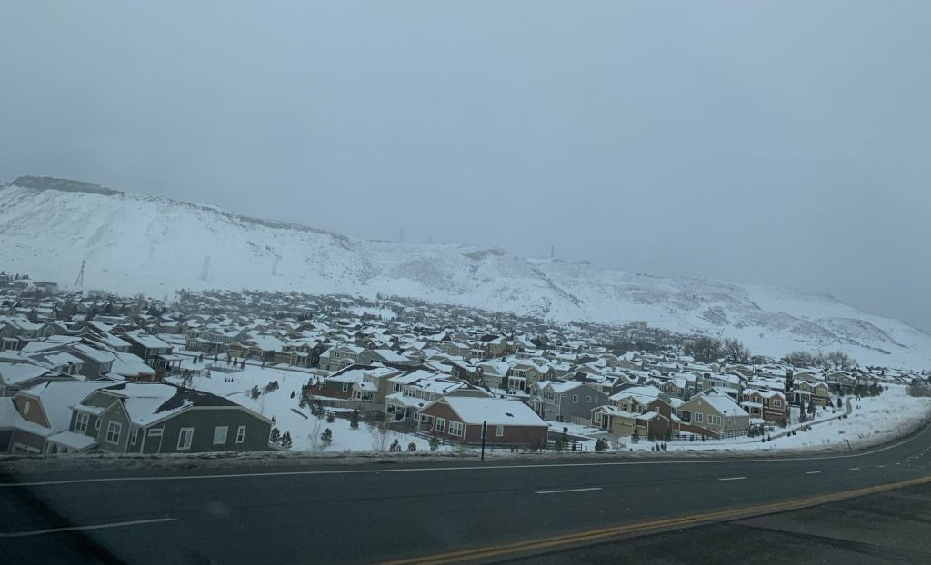 Snowy houses by the highway